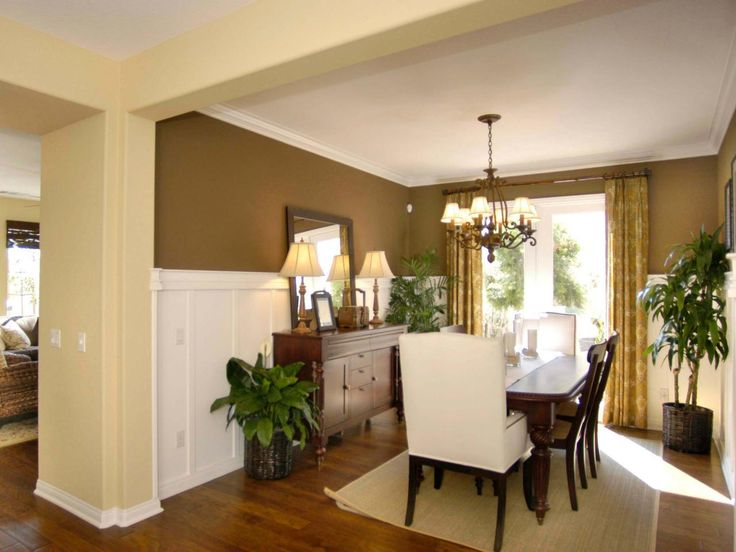 A Small Formal Dining Room Combines Elegant Gold And Brown Tones The Table Sideboard Have Massive Carved Legs Wainscoting Is Unusually Tall But