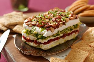 Memo to self: This savory Layered Sundried Tomato and Artichoke Spread will wow my co-workers at the office potluck. Serve with RITZ Crackers.