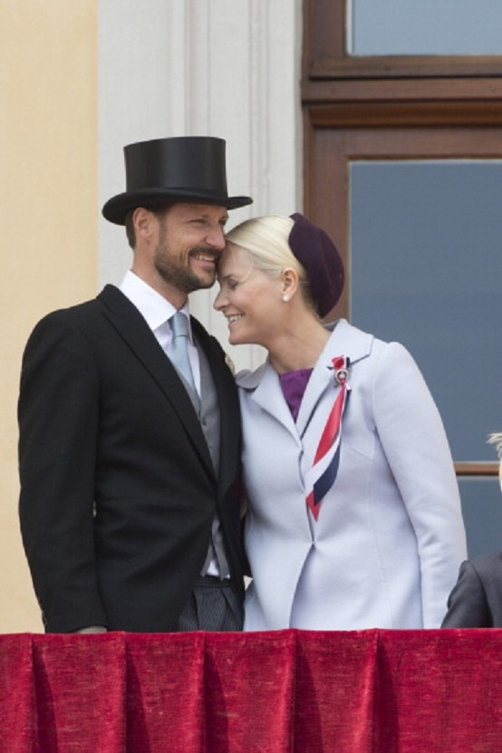 Crown Prince Haakon, and Crown Princess Mette-Marit of Norway, watch the annual Norwegian National Day parade from the balcony of The Royal Palace in Oslo on 17 May 2013