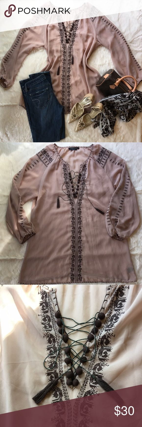 """BCBGMaxAzria top Gorgeous blush colored BGBC Maxazria tunic. Lace up neckline adorned in chocolate colored tiny pop pops. Sticking is in the coordinating chocolate color. Selves are also stocked and finished off with a tiny pop pop. There is a small rip by the neckline as shown in the picture. It measures 30"""" long. Bust measures 44"""". BCBGMaxAzria Tops Tunics"""