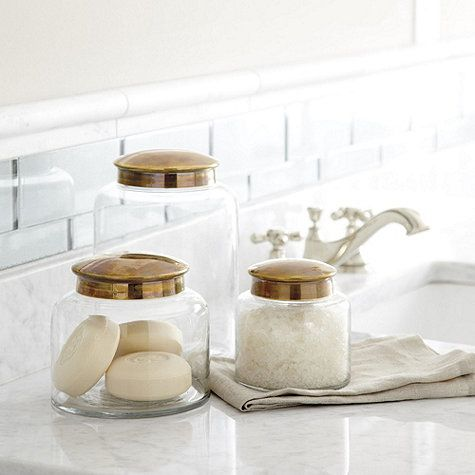 Apothecary jars are a pretty way to add storage to a guest for Bathroom apothecary jar ideas