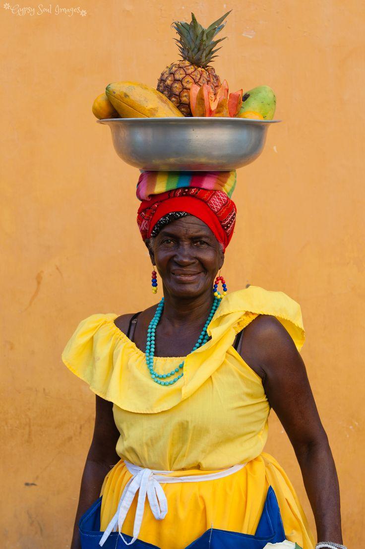A colourful La Palenquera lady in Cartagena, Colombia