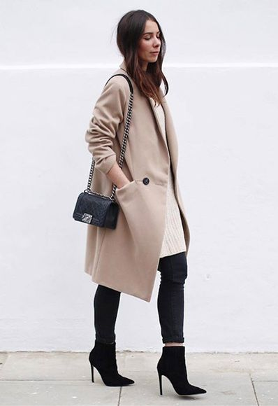 ASOS Insider Alice wears a longline camel coat with black skinny jeans and pointed ankle boots