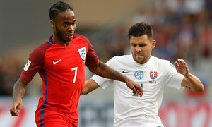 Raheem Sterling in action with Slovakia's Michal Duris.