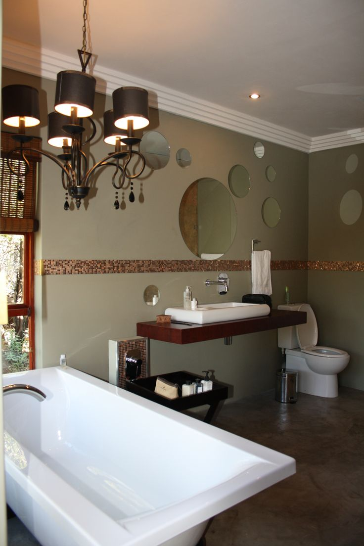 a beautiful bathroom interior at Arendsig villa. no better way to take a relaxing bath than in a exotic bath tub