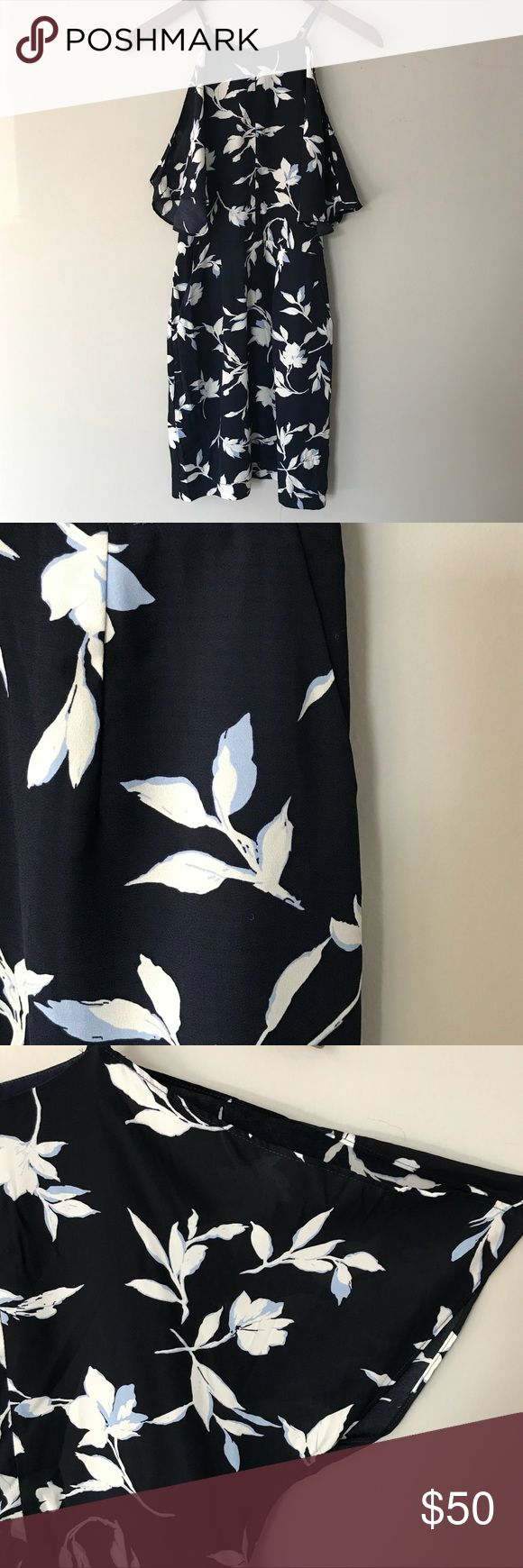 Adelyn Rae Navy Floral Dress In great condition! Worn once for a wedding. Love that there is pockets and adjustable straps. Fits true to size. Adelyn Rae Dresses Midi