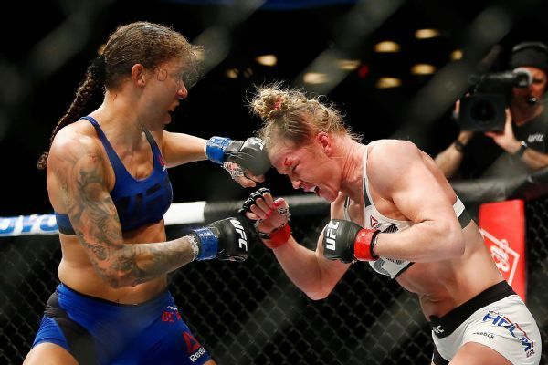 """NEW YORK — Cris """"Cyborg"""" Justino was not in the Octagon for the UFC's first 145-pound female title fight on Saturday night — but at least she was in the building. Justino (17-1) was cageside at UFC 208 to witness Germaine de Randamie's historic win over..."""