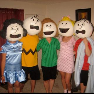 So this was a pretty simple project. We bought beach balls and covered them with about 5 layers of  paper mâché. Once they were dry we cut out neck holes and spray painted them white. Next we cut out the mouth area and hot glued sheer black fabric on the upper lip inside of the head (the mouth is where you will see out of). For hair we used pipe cleaners (Linus/Charlie Brown), yarn (Sally/Peppermint Patty) and stuffing spray painted black (Lucy). We used black sharpies to draw the facial…