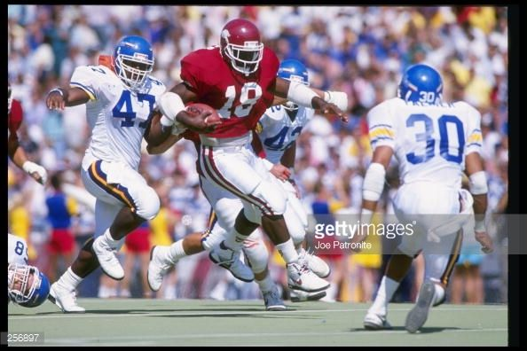 arkansas football 1989 | Running back Barry Foster of the Arkansas Razorbacks runs down the ...