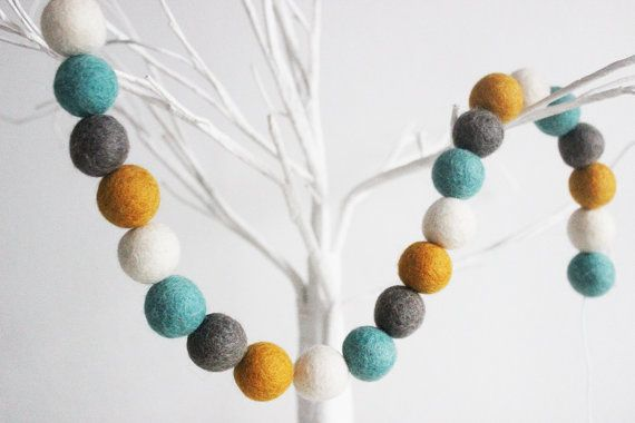 This Mustard, Teal , White & Grey Felt ball Garland makes the perfect finishing touch to your little ones nursery. As well as a kids bedroom decor, you can use it to decorate a baby shower, party or even a wedding. This pom pom garland is made from 28 felt balls which were handmade in Nepal. Each ball is approximately 2.5cm, and strung along a 2 metre cotton string. The smaller garland is 130cm long. -Each wool felt ball = 1 inch (2.5 cm) x28 -Hand felted (may vary slightly in size due to…