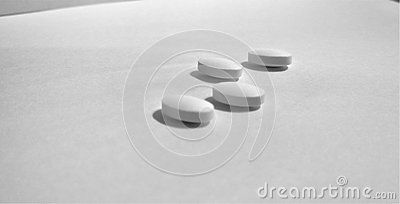 A shot of unlabeled ibuprofen pills on a white background. Since they have no labels or writings they could be used in any context.