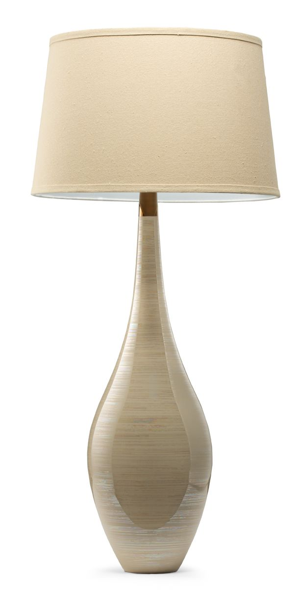 Frankie Table Lamp: Beige Table lamps offer the ultimate in the form-and-function department. They bring light to any area: in the living room on a side table, in the master on a bedside table. And the variety of materials and styles is endless, from ceramic to metal to glass.