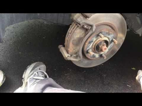 Change brake pads on a Nissan Versa brakepads brake replacement how to do it yourself quick - YouTube
