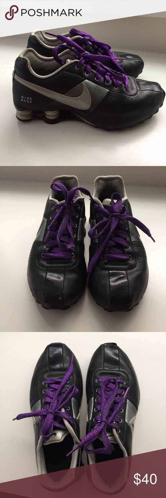 Black Nike Shock Sneakers Black and grey/silver sneakers.  Laces are glitter purple. Normal wear on sneakers, good condition other than front top of right & wear on top of where your fit goes in Nike Shoes Sneakers