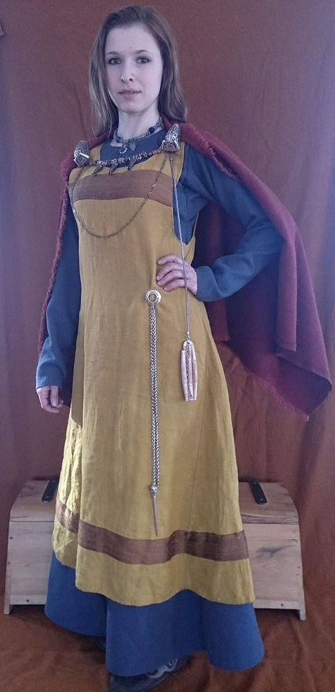Viking dress, shown on russian website. The ochre colour of the apron dress is probably very realistc for the period, whilst blue was rather expensive, as it was achieved by using indigo, which came, via arab traders, all the way from India. Thus blue was usually the colour of the nobility. But then, that is most likely the case with this garb, as the awesome tortoise brooches, and silver beads, make her a highborn, or rich, lady! Заявка на Русборг-2015