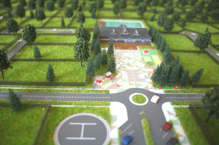 """The models of the cottage settlement """"Republic Santoro"""". The model is made for landscape, playgrounds, props, and home made 372.  Customer the task was to create houses that can be freely moved around the layout. So the house to the landscape not attached and are able to operated separately.  For houses manufactured a special container allowing you to carry them separately from the layout. Макет коттеджного поселка """"Республика Сантория"""". На макете выполнен ландшафт, детские площадки…"""