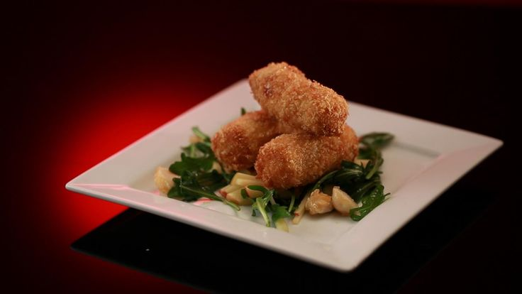 Annie and Jason's Goat's Cheese Croquettes with Rocket and Apple Salad and Caramelized macadamias from Season 5 of MKR: http://gustotv.com/recipes/appetizer/goats-cheese-croquettes-rocket-apple-salad-caramelised-macadamias/