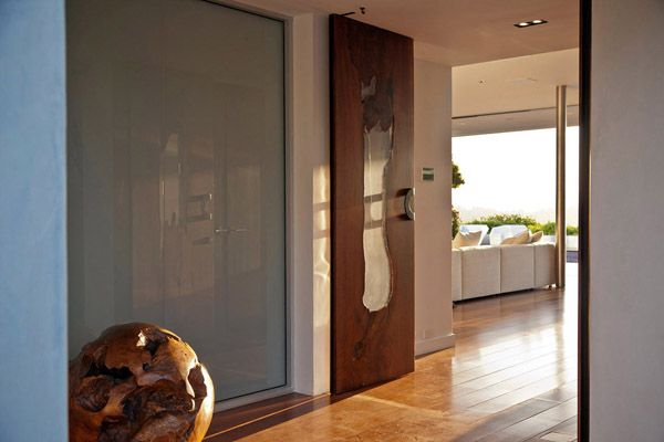 Stunning mid-century modern Beverly Hills House. Our entry doors made of black walnut and acrylic.