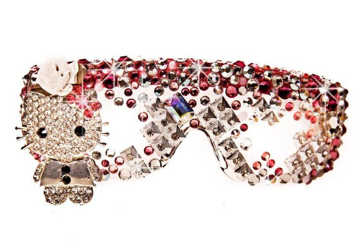 The famous Hello Kitty eyewear by Jaesyn Burke is hand beaded with genuine multi-pink, clear, and iridescent Swarovski crystals, crystallized spikes, oversized jewels, rosettes, and a crystallized Hello Kitty figurine. The eyewear also comes with a custom drawstring bag also made by the designer. Please allow 3-4 weeks for delivery. REG. PRICE 200.00, SALE PRICE: 140.00. NOTE: MATCH THIS EYEWEAR WITH YOUR FAVORITE CLUTCH BAG, SOLD SEPARATELY, AS IN THE PICS. INTERNATIONAL SHIPPING C...