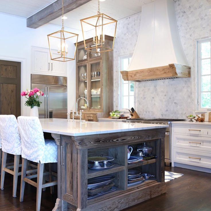 White kitchen with natural wood accents.  oldseagrovehomes