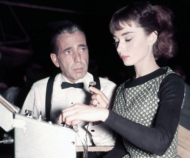 "Humphrey Bogart and Audrey Hepburn on set of ""Sabrina"",1954."