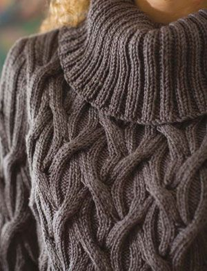 Chisel pullover features a generous ribbed neckline with an all-over cable pattern resembling woven vines.