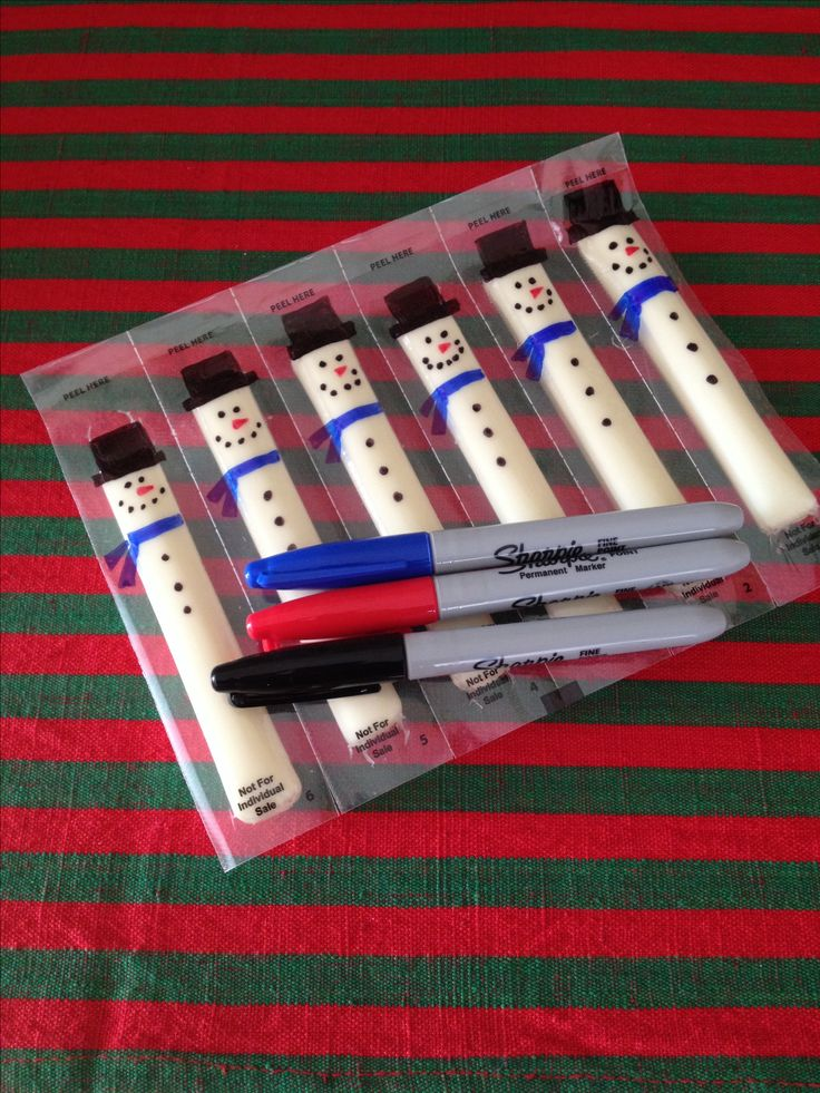 String Cheese snowmen made by using only Sharpies. Check the string cheese before you attempt this - some packages have writing/logo at the tops of the string cheese.
