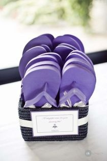 Purple flip flops favours for guests - great idea for a beach wedding should also do green. Purple for women and green for men.