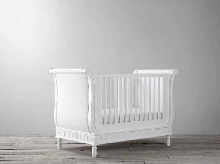 The belle sleigh cot bed offers a french simplicity unrivaled by any other cot company.A truly unique piece that will be treasured for years to come.The cot features end panels with beautiful upholstered sides, using wipe clean faux suede fabric.Handcrafted from solid wood, it is built to last. With its adjustable mattress positions, it is suitable from birth it then becomes a toddler bed and, ultimately, an elegant sofa bed. www.Bambizi.co.uk