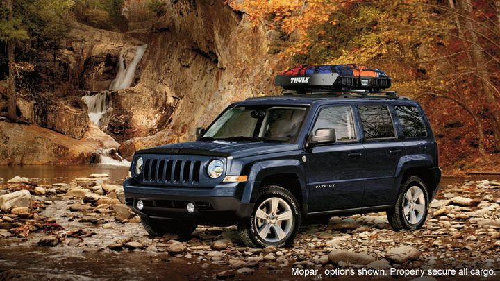 Patriot Latitude 4x4 shown in True Blue Pearl with available Freedom Drive II® Off-Road Group and available Authentic Jeep® vehicle accessories by Mopar®. Properly secure all cargo.