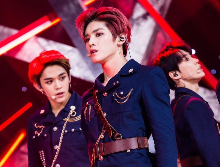 We have Taeyong and Lucas looking inhumanly good here. And then there's Doyoung.