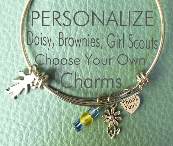 Neat idea to make a charm bracelet out of large key rings...