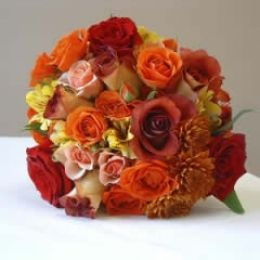 Different red and orange roses make this a nice fall wedding flower bouquet.