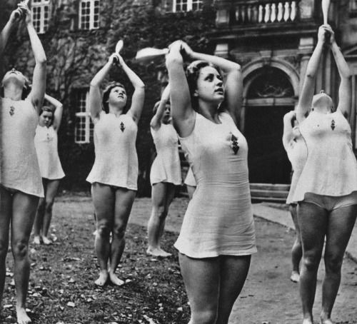 """Young German girls perform calisthenics as part of the """"Mind and Body"""" policies for building physically and mentally able youth. Description from pinterest.com. I searched for this on bing.com/images"""