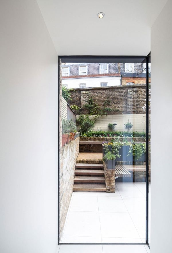 How about a lightwell or courtyard between the extension and the barn? Slim profile metal glazing