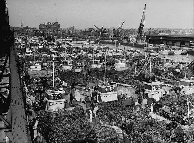 """""""D"""" Day preparations. Overhead shot showing part of the huge invasion fleet: Landing Craft, Tanks (LCTs) fully loaded and camouflaged. Photographer:Frank L. Dubervill"""