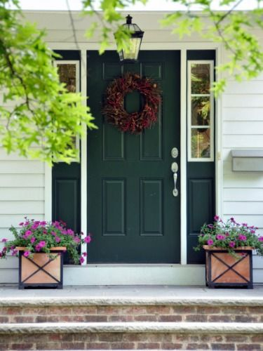 A hunter green door buoyed by clean, white trim will never go out of style. See more colorful doors >>