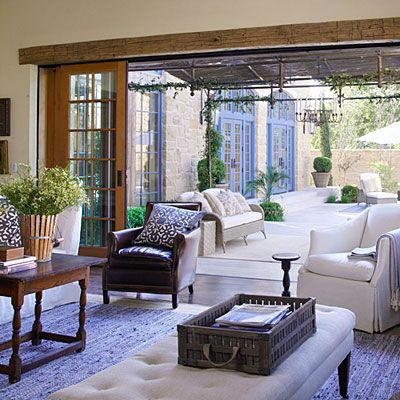 Sliding glass & screen pocket doors disappear completely into the wall to open the family room to the terrace. + Antique fir headers crown the new sliding doors w/ a rustic element.
