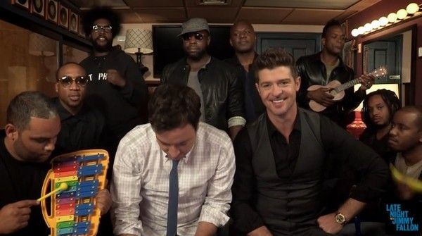 Robin Thicke performs 'Blurred Lines' with Jimmy Fallon, the Roots and toys http://www.examiner.com/article/robin-thicke-performs-blurred-lines-with-jimmy-fallon-the-roots-and-toys