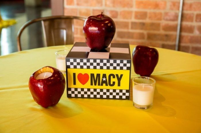 These cute Bat Mitzvah centerpieces were made with scooped out apples with votive candles placed inside! See all the party details at MitzvahMarket.com.