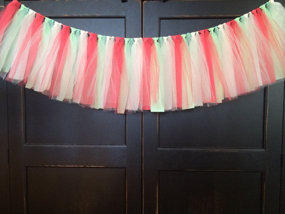This feminine rag tie garland is made of tulle and cotton/cotton blend fabric strips in shades of coral, cream, and mint attached to a natural twine. Perfect for a girls birthday party, cake smash, candy buffet, baby shower, bedroom, nursery, photo prop, etc. Hang it on a buffet table or as a backdrop, drape it over a curtain rod as a valance or any number of places! The fabric portion of the line runs in three size options: 3 ft (.91 m), 4 ft (1.22 m), and 5 ft (1.52 m) wide with an added 3…