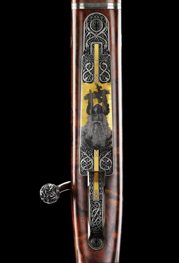 VO Viking Oden rifle bottom metal. Look at the detail!! Screw heads are carved. The dragons below Odin are very cool... Huginn and Muninn in the background... HIS BEARD!!! :sheesh: Only $300,000 :-D