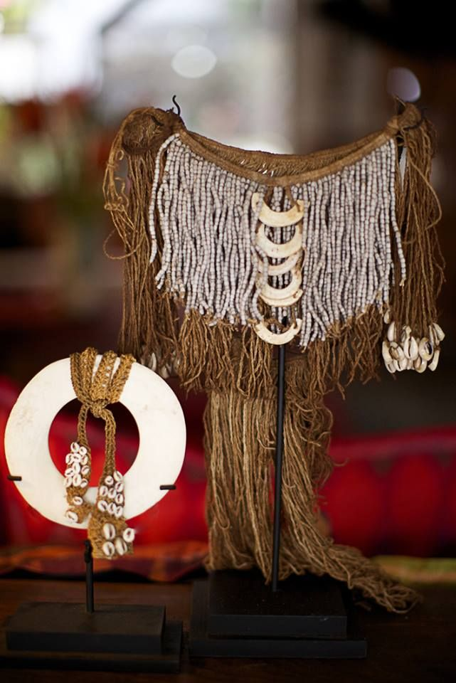 Fine twine and shell ceremonial skirt and small kina shell adorned from the Abelam village of New Guinea.
