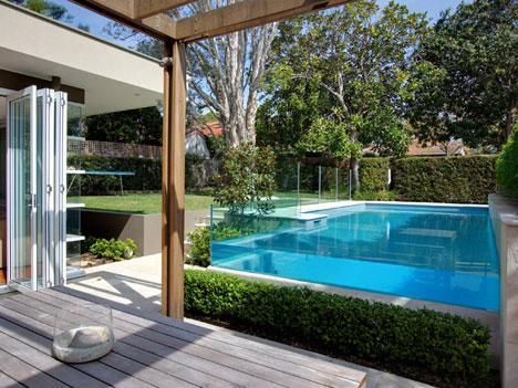Pool with glass wall pride pools pool pinterest glass walls and swimming pools for Glass swimming pool walls cost