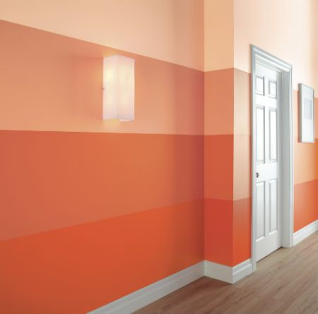 This high-impact hallway from has been treated to a stunning ombré-inspired paint treatment. The paint colours from top to bottom are Behr's Friendship 220A-2, Orange Grove 220B-4, Tangerine Dream 210B-5 and Flame 210B-7, from The Home Depot DreamBook.
