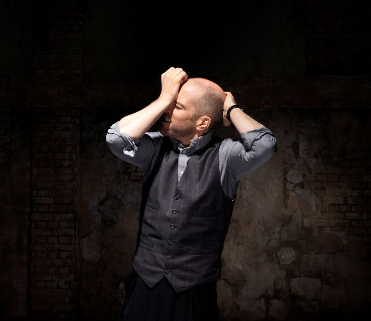 Love the subtle plaid and the cut, but I'm not sure about four welt pockets. This is the illusionist Derren Brown and he wears a lot of great vests.