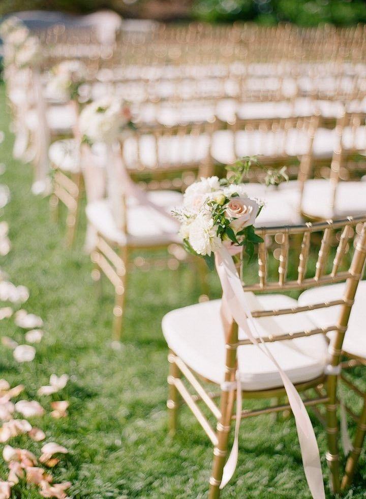 elegant gold wedding ceremony chairs; photo: Nadia Hung