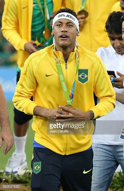 Neymar of Brazil celebrates winning the gold medal following the Men's Soccer Final between Brazil and Germany on day 15 of the Rio 2016 Olympic...