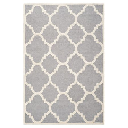 Tufted wool rug with a quatrefoil trellis motif. Made in India.  Product: RugConstruction Material: Wool