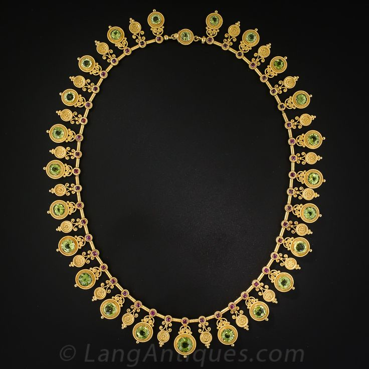 Antique 22K Etruscan Revival Peridot and Ruby Necklace by Marchesini. This is a magnificent 22k Italian neckpiece designed by Marchesini* around 1870, impeccably crafted and in pristine condition. It is rendered in an archaeological style, focusing on the fine filigree and granulation which was inspired by the jewels discovered in ancient Etruscan tombs unearthed in Italy in the 1800's.